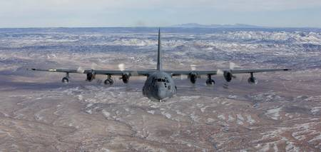 An MC-130 aircraft manuevers during a training mis