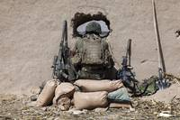 A U.S. Marine sniper observes his sector at a patr