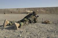 An Afghan Commando engages training targets on the