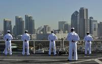 Sailors man the rails aboard the hospital ship USN