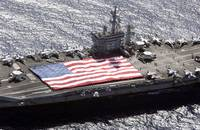 Personnel participate in a flag unfurling rehearsa