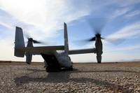 An MV-22 Osprey sits outside a forward operating b