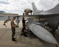 Maintenance crew works on replacing a wing fuel ta