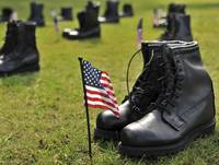 Combat boots are placed in formation representing