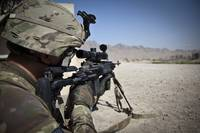 U.S. Army sniper pulls security using an Mk14 Enha