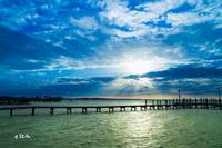Lonely Pier Shimmering Sea Sky Blue Sun Rays Cloud