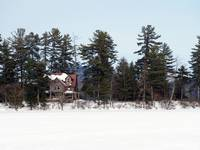 House on Big Moose Lake in the Adirondacks in Wint
