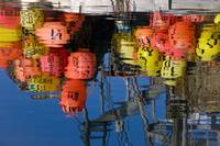 Fishing Boat Buoys And Gear Reflect In Water, Alas