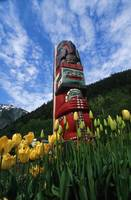 Totem pole with tulips Juneau Southeast Alaska mou