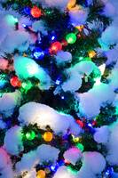 Close up of a multi colored Christmas tree lit at
