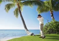 Hawaii, Oahu, Male Ready To Swing His Golf Club At