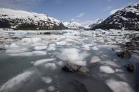 Ice melts in glacial river in snowy landscape