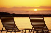 Hawaii, Two Silhouetted Chairs On Beach At Sunset,