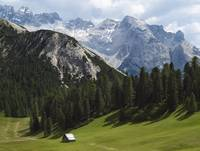 Summer Alpine Meadows And Hut Italy