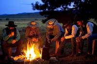 Group Of Cowboys Around A Campfire