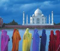 Women In Colorful Saris In Front Of The Taj Mahal