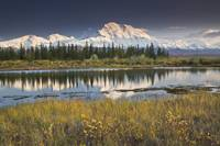 North face and peak of Mt. Mckinley reflected in t