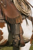 A Close-Up Of A Roper On Horseback