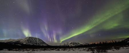 Aurora Borealis Or Northern Lights Above The Mount
