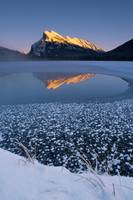 Icy Lake, Mountains In Background Alberta, Canada