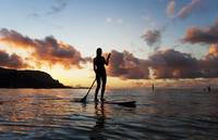 Hawaii, Kauai, Woman Stand Up Paddling In Ocean, B