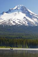 Boating In Trillium Lake With Mount Hood In The Ba