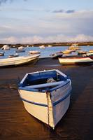 Boats Moored Near The Harbor Of Chiclana De La Fro