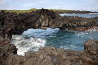 Hawaii, Maui, Hana, Lava rock formation arches ove
