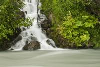 A cascading waterfall flows into Granite Creek, Tu