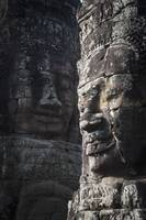 Face sculptures on stone walls at angkor wat, Camb
