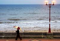 Lady With An Umbrella Walking Along Bridlington Pr