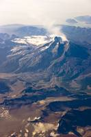 Aerial view of Mount Redoubt with steam coming out