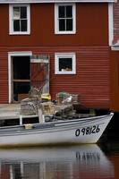 Fishing Boat In Front Of A Red Shed, Newfoundland