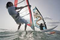 Two windsurfers side by side in the water, Tarifa,