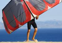 Man Holding Kite For Surfing, Costa De La Luz, And