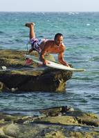Man Jumping Into The Water On His Surf Board