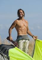 A Man Preparing To Kite Surf On Dos Mares Beach, T