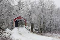 Red Covered Bridge In The Winter Adamsville Quebe