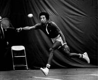Arthur Ashe returning tennis ball