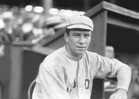 Tris Speaker leaning against dugout