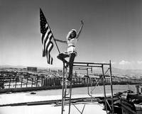 Women holds flag proudly