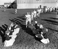 Cheerleaders encourage football players