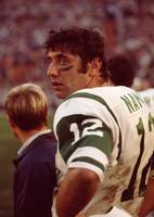 Joe Namath catching a breath on the sidelines