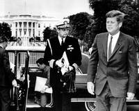 John F. Kennedy exits limo in front of White House