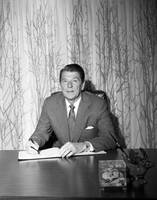 President Ronald Reagan behind desk