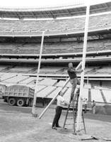 New York Jets football crew works on field goal re
