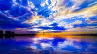 Blue and White Seascape with Sunset Reflection Art