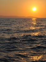 Sunset at adriatic sea with ripples