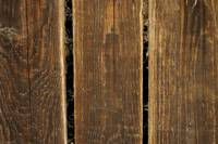Old brown wooden planks with spider web