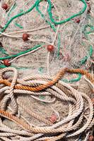 Pile of fishing nets with floats